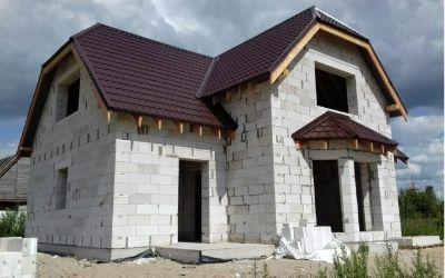 из какого материала дешевле построить дом фото